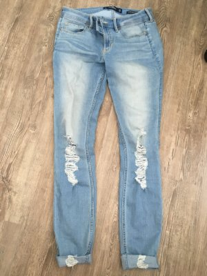 Hollister Jeans Hose Low-rise Super Skinny Größe 7L W28 L32 destroyed Löcher