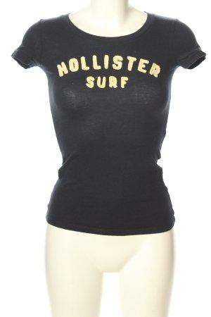 Hollister T-Shirt schwarz-blassgelb Schriftzug gedruckt Casual-Look