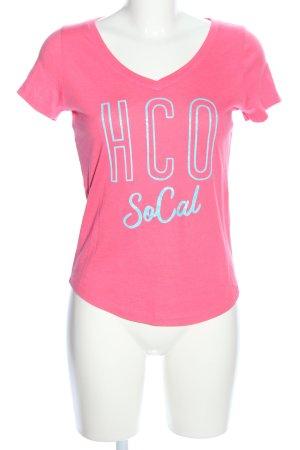 Hollister V-Ausschnitt-Shirt pink Schriftzug gedruckt Casual-Look
