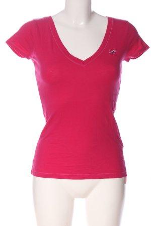 Hollister V-Ausschnitt-Shirt pink Schriftzug gestickt Casual-Look