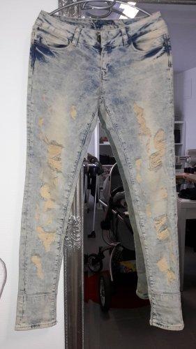 Jeans flare blanc-bleu pâle