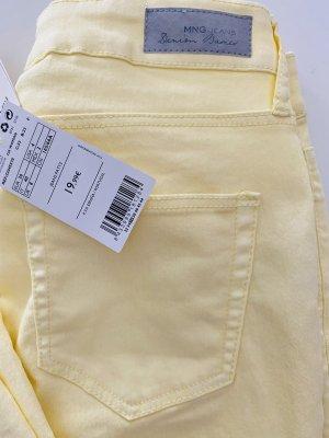 Mango Spodnie ze stretchu żółty