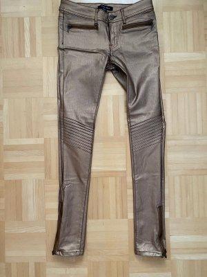 Amisu Spodnie ze stretchu złoto-w kolorze różowego złota