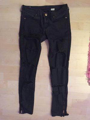 Hose rippend risse Löcher Used Look Biker Reißverschluss schwarz Jeans