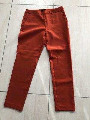 Cortefiel 7/8 Length Trousers dark orange