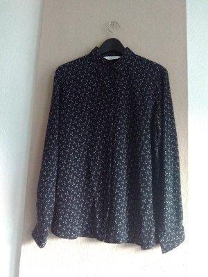 hübsche Hemdbluse in schwarz-weiss aus 100% Seide, Grösse 40
