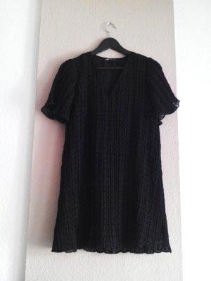 hübsches Plissee- Minikleid in schwarz, gepunktet, Größe S