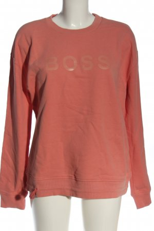Hugo Boss Suéter rosa letras impresas look casual