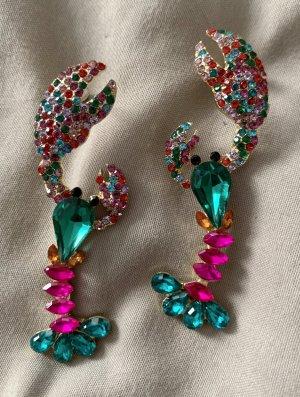 Boucle d'oreille incrustée de pierres multicolore verre