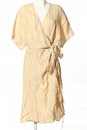 Indiska Vestido cruzado naranja claro-blanco estampado a rayas look casual