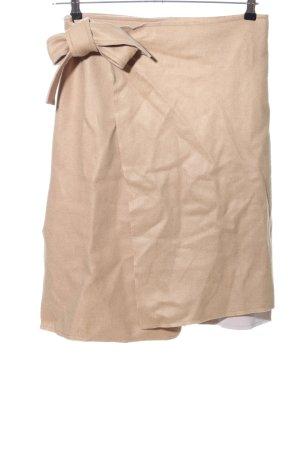 Falda cruzada nude elegante