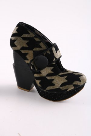 Irregular choice Plateau-Pumps schwarz-goldfarben Allover-Druck