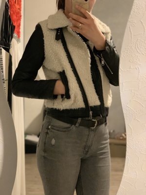 Giacca in eco pelliccia bianco-nero