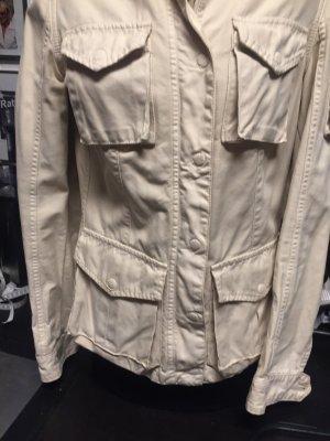 Jacke in hellbeige mit Brust-, Seiten- und einer Ärmeltasche, ZIPP Reißverschluss plus Druckknöpfe