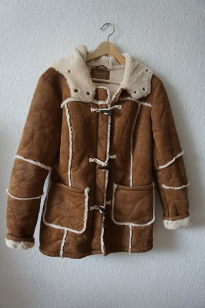 Jacke mit Teddyfell und Ziernähten