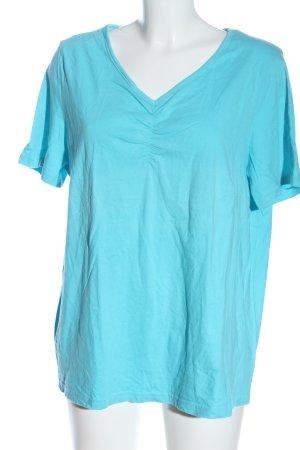 Janina Curved Camisa con cuello V azul look casual