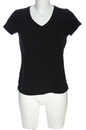 Janina Schreck Camisa con cuello V negro look casual