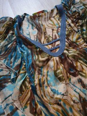 Jaune Rouge / Tunika / Tunika-Shirt / V-Ausschnitt / Volant-Ärmel / Volants / transparent / blau