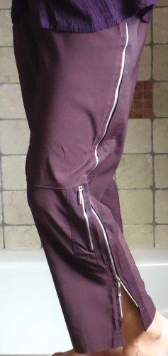 Jean Marc Philippe Paris, exclusive Hose in einem dunkelviolett, mauve Ton, dunkelrot, aubergine, Viskose, PA, Lycra, einzigartiges Design mit Längs Zipp an der Seitennaht, Zipptaschen, sehr angenehmes, dehnbares Material, Schlupfhose, 7/8 Länge, knöchell