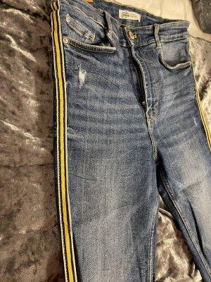 Jeans mit gelben Streifen