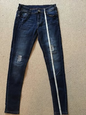 Jeans mit Glitzerlöchern