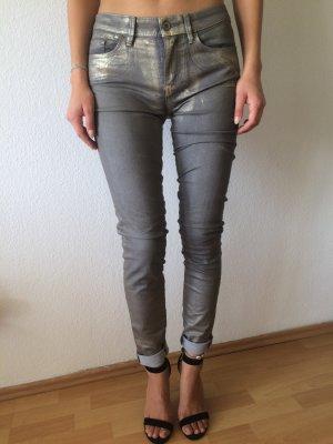 Jeans mit goldenem Schimmer