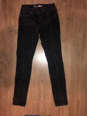 Jeans mit Schlangenmuster