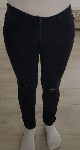 Jeanshose in schwarz mit Cut-outs