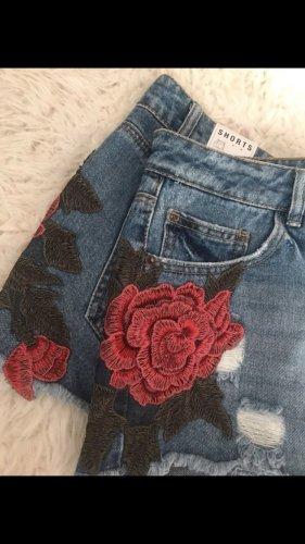 Jeanshose mit Rosen