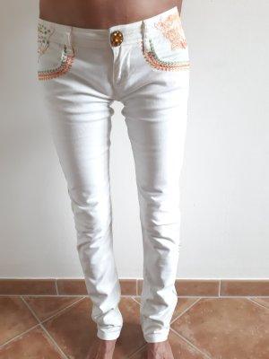 Desigual Spodnie biodrówki w kolorze białej wełny