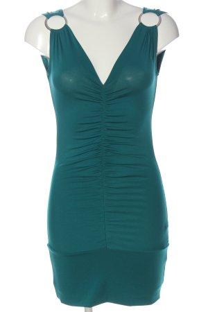 Jennifer Taylor Mini vestido turquesa look casual