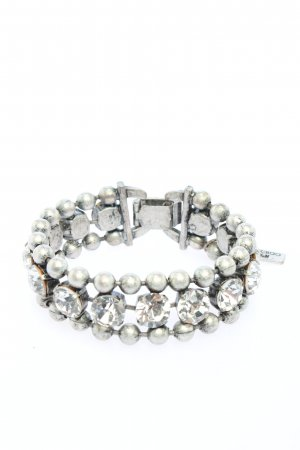 Jimmy Choo for H&M Pulsera color plata look casual