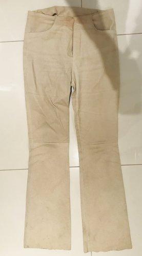 Pantalón de cuero color oro