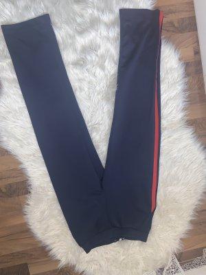 a wear Pantalon en jersey bleu foncé-rouge