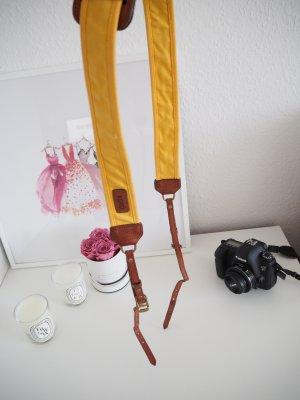 Suspenders gold orange leather