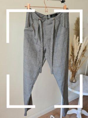 Plain Studios Pantalone peg-top bianco-grigio