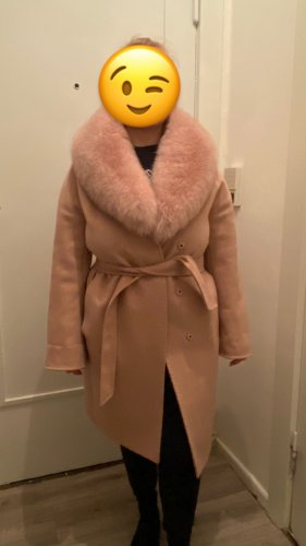 Manteau de fourrure or rose
