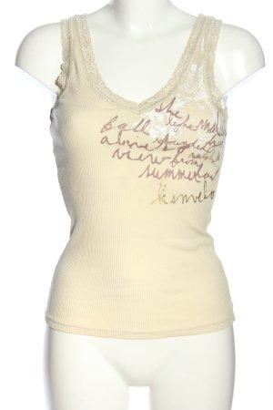 Kenvelo Top di merletto crema-marrone caratteri stampati stile casual