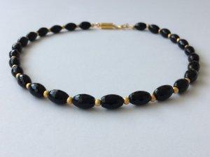 Collier nero-oro