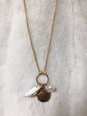 Collana di conchiglie oro-bianco