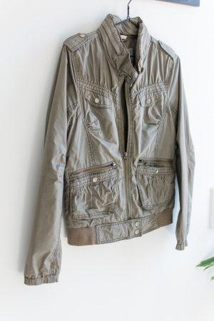 H&M Divided Kurtka przejściowa khaki Tkanina z mieszanych włókien