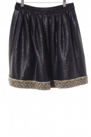 Kinga Mathe Glockenrock goldfarben-schwarz extravaganter Stil