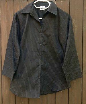 Klassische Schwarz-weiße Bluse