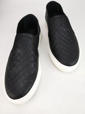 Klassische schwarze Slippers von Gucci