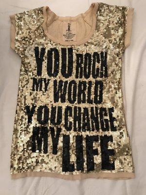 Kleid aus Pailletten in Gold