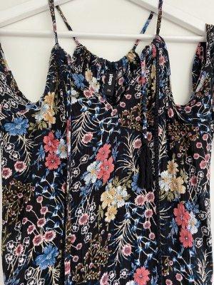 Kleid mit cut-outs neuwertig Eksept Größe XS schwarz mit bunten Blumen