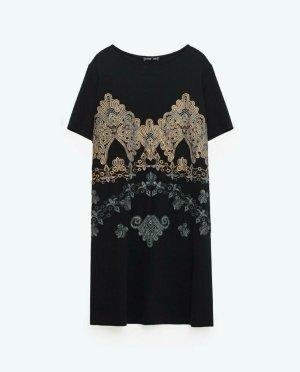 Kleid von Zara in Schwarz mit goldenem Print Gr. XS