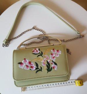 kleine grüne Umhängetasche mit Blumenmuster