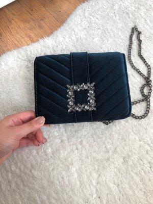 Kleine samtblaue Handtasche