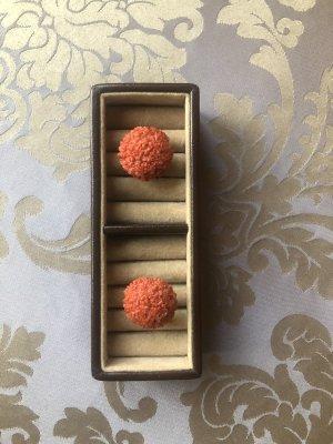 Clip d'oreille orange fluo-saumon